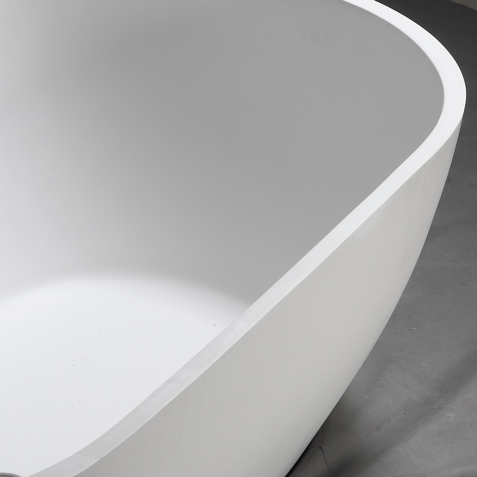 standing red oval solid surface bathtub boat Bellissimo Brand